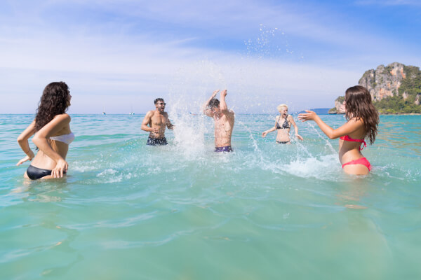 group of friends splashing in the water
