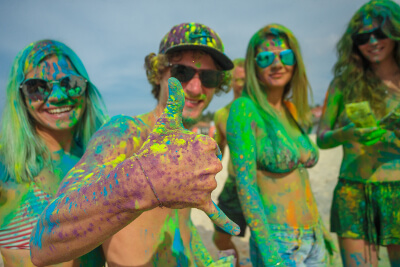 friends having fun covered in colored dust