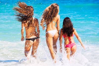 girls running through the ocean
