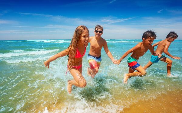 kids running in the ocean